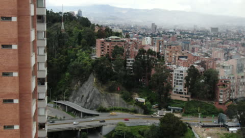aerial drone view over cityscape in colombia - colombia stock videos & royalty-free footage