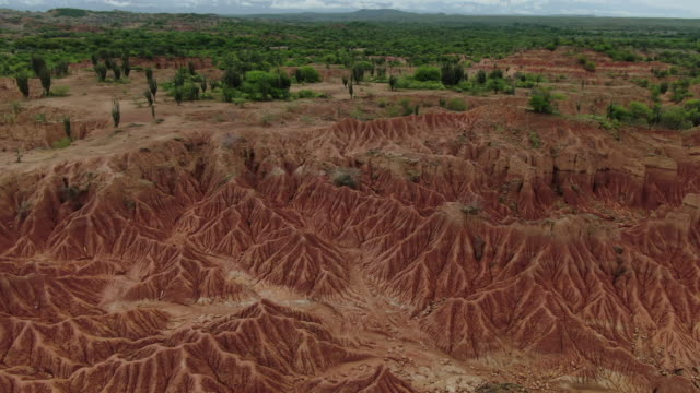 aerial drone view over tatacoa desert in colombia on cloudy day - colombia stock videos & royalty-free footage