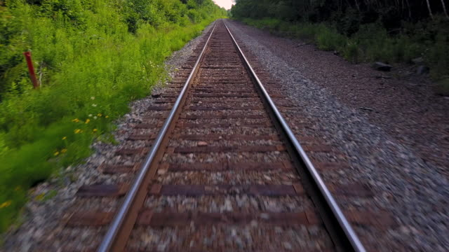 aerial drone view: railroad tracks - railroad track stock videos & royalty-free footage