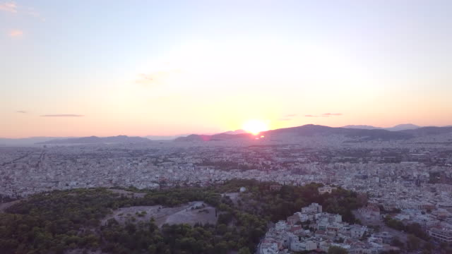 vidéos et rushes de aerial drone view sunset over athens, greece. - time-lapse - capitales internationales