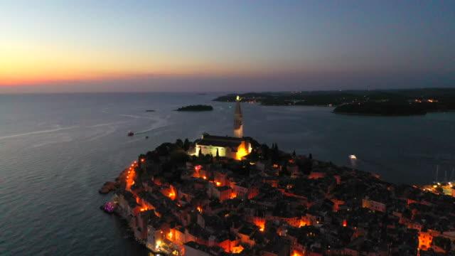 vidéos et rushes de aerial drone view sunset scene of historical center of rovinj old town, istria region, croatia, europe - toit en tuiles