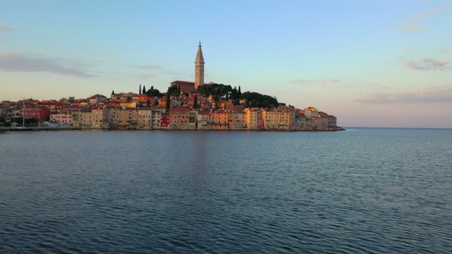 aerial drone view sunset scene of historical center of rovinj old town, istria region, croatia, europe - croazia video stock e b–roll