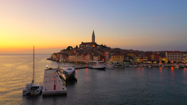 aerial drone view sunset scene of historical center of rovinj old town, istria region, croatia, europe - saturated colour stock videos & royalty-free footage