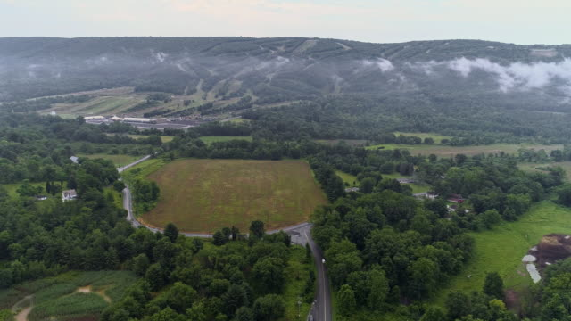 Aerial drone view to the Blue Mountains covered by low clouds, Poconos, Pennsylvania, at the early morning.