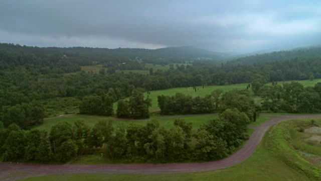 aerial drone view to the blue mountains covered by low clouds, poconos, pennsylvania, at the early morning. - appalachian mountains stock videos & royalty-free footage