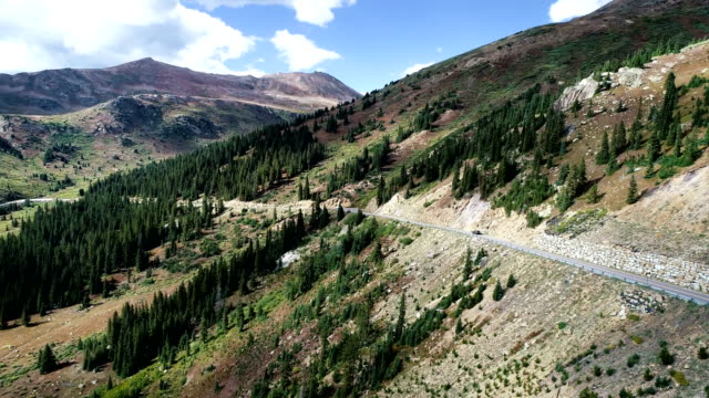 aerial drone view turning around entire pass aspen , colorado mountain valley - aspen tree stock videos and b-roll footage