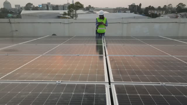 aerial drone views engineer checking install a solar panel . - control stock videos & royalty-free footage