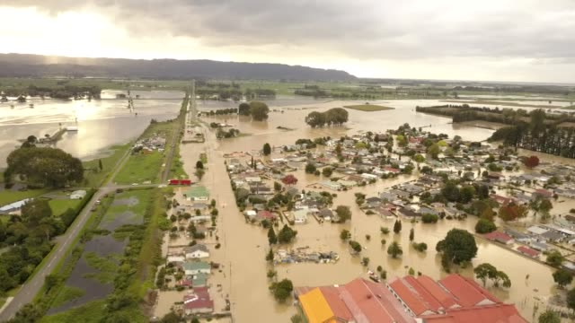 aerial drone views of severe flooding in town of edgecumbe with submerged buildings and flood plains - extreme weather stock videos & royalty-free footage