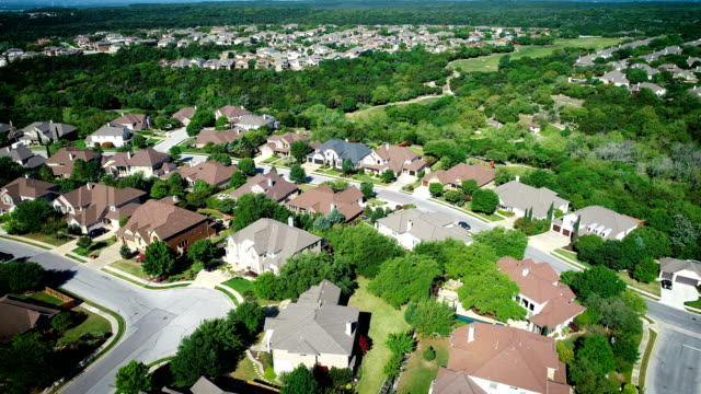 aerial drone views orbiting above green texas hill country luxury homes - cedar park texas stock videos & royalty-free footage