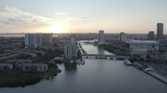 aerial drone-city waterway-sunset - tampa stock videos & royalty-free footage