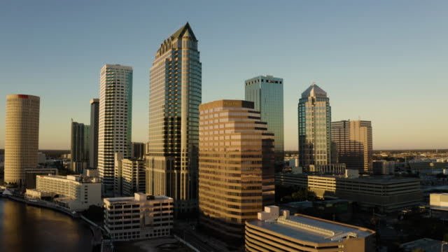 aerial drone-city-sunset - tampa stock videos & royalty-free footage