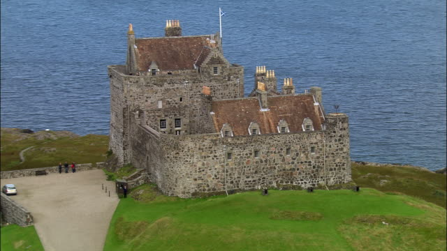 Aerial Duart Castle overlooking Sound of Mull on coast of Isle of Mull / Scotland