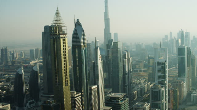 aerial dubai burj khalifa sheikh zayed road uae - luogo d'interesse internazionale video stock e b–roll