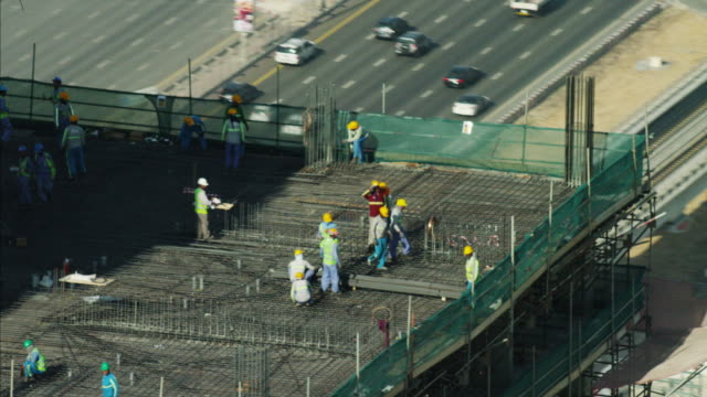Aerial Dubai Construction workers people highrise building UAE