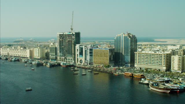 aerial dubai creek commercial spice port dhow vessels - golfstaaten stock-videos und b-roll-filmmaterial