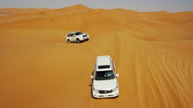 Aerial Dubai Drone view of Desert dune vehicles