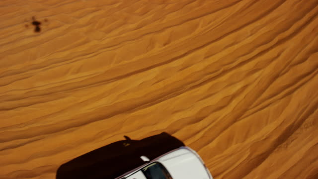 aerial dubai drone view of desert dune vehicles - sand dune stock videos and b-roll footage