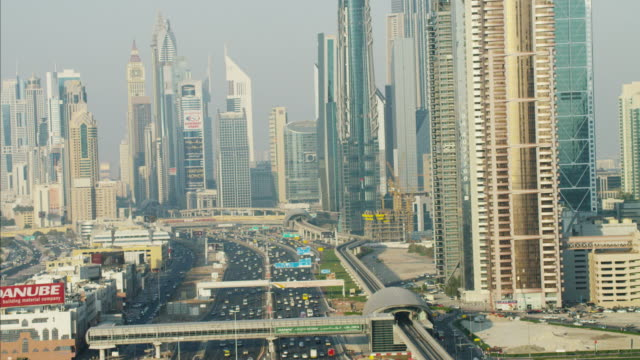 aerial dubai metro sheikh zayed road emirates towers - railroad car stock videos and b-roll footage