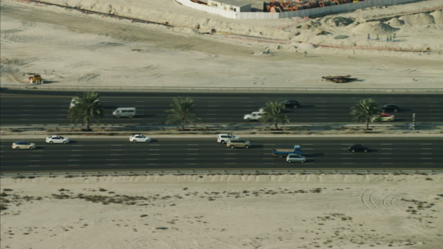 Aerial Dubai Road commuter traffic multi lane desert