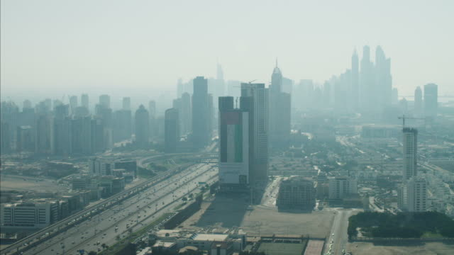 aerial dubai sheikh zayed road commuter traffic uae - vereinigte arabische emirate stock-videos und b-roll-filmmaterial