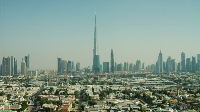 aerial dubai skyline burj khalifa skyscraper residential homes - dubai stock videos & royalty-free footage