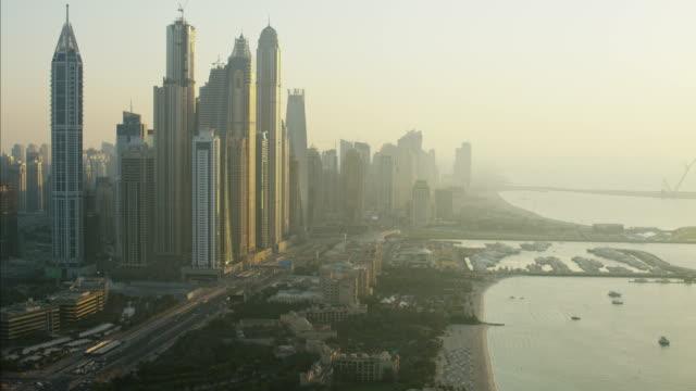 aerial dubai skyscrapers media city yacht marina persian - marina stock videos & royalty-free footage