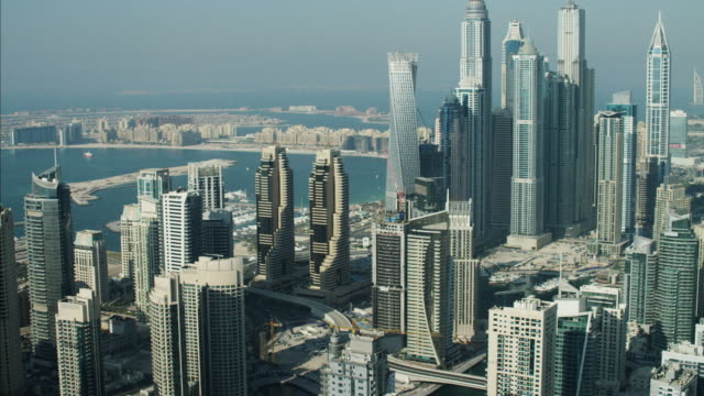 vidéos et rushes de aerial dubai skyscrapers palm jumeirah reclaimed land uae - dubai