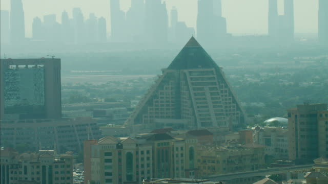 aerial dubai skyscrapers raffles wafi city persian gulf - raffles city stock videos & royalty-free footage