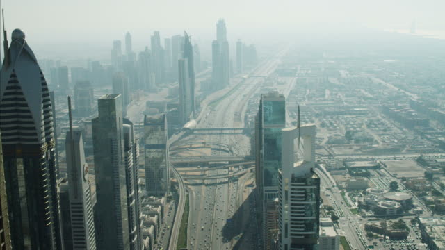 aerial dubai skyscrapers sheikh zayed road traffic intersection - 金融と経済点の映像素材/bロール