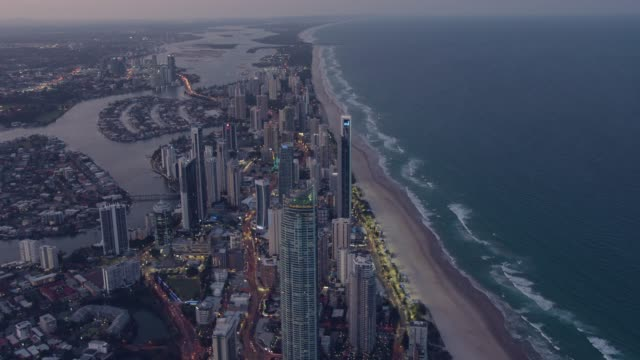 aerial dusk illuminated view surfers paradise skyscrapers australia - dusk stock videos & royalty-free footage