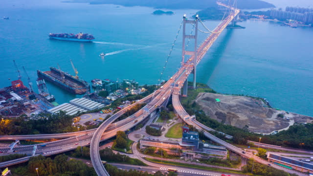 aerial dusk to night time lapse of ting kau bridge, hong kong - bridge built structure stock videos & royalty-free footage