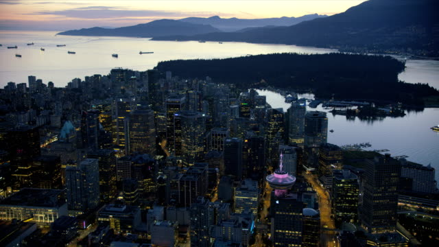 stockvideo's en b-roll-footage met aerial dusk view downtown vancouver british columbia canada - mountain range