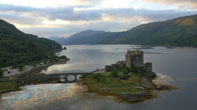 aerial dusk view eilean donan castle loch duich - scottish culture video stock e b–roll