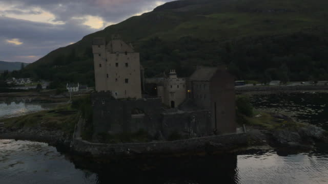 aerial dusk view eilean donan castle people hiking - dornie stock videos & royalty-free footage