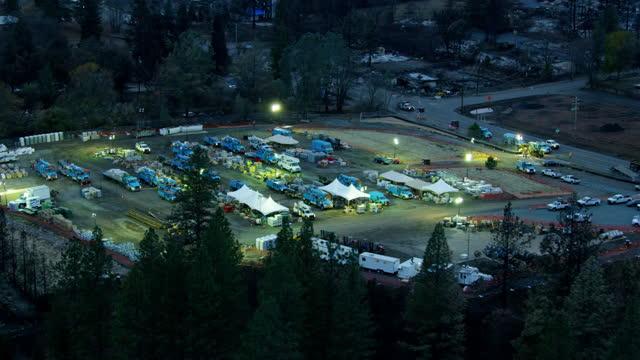 aerial dusk view fema utility vehicles paradise california - burnt stock videos & royalty-free footage