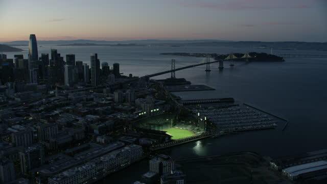 aerial dusk view san francisco illuminated oracle park - san francisco california stock videos & royalty-free footage