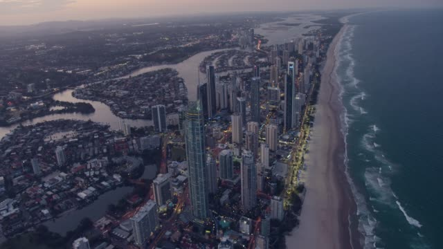 aerial dusk view surfers paradise skyscraper gold coast - dusk stock videos & royalty-free footage