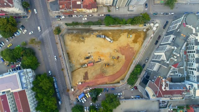 aerial eagle eye ascending shot of city construction site in business district sofia, bulgaria - bulgaria video stock e b–roll
