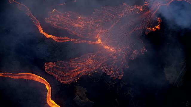 aerial earth view of liquid volcanic lava flowing - tectonic stock videos & royalty-free footage