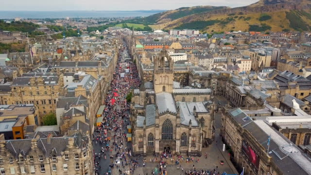 aerial /edinburgh festival  and visitors along the royal mile - royal mile stock videos and b-roll footage