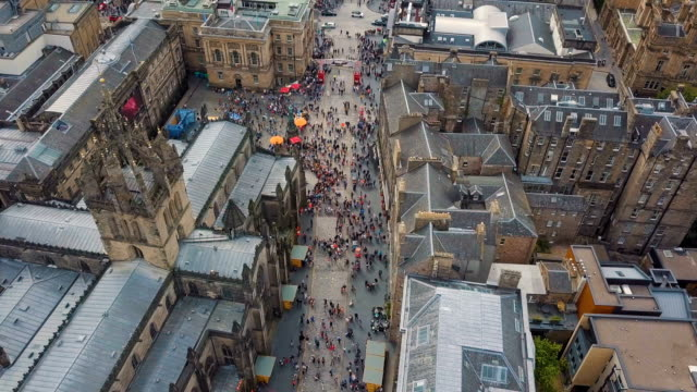 aerial /edinburgh festival  and visitors on the royal mile - edinburgh scotland stock videos & royalty-free footage