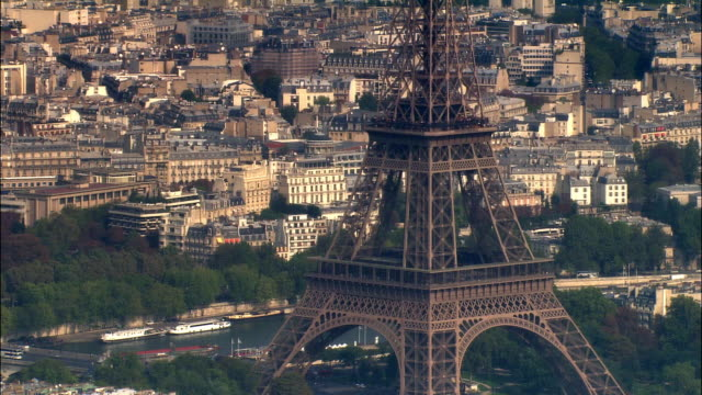 Aerial WS TU Eiffel Tower and surrounding cityscape near bank of River Seine / Paris, France / Paris, France