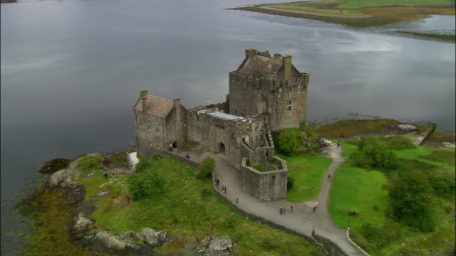 Aerial Eilean Donan castle on Loch Duich in western Scottish Highlands / Scotland
