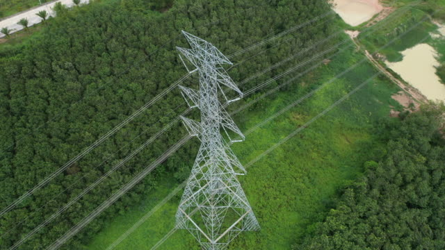 aerial electricity pylons in the rural scene - power line stock videos & royalty-free footage