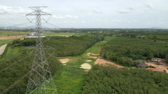 aerial electricity pylons in the rural scene - column stock videos & royalty-free footage