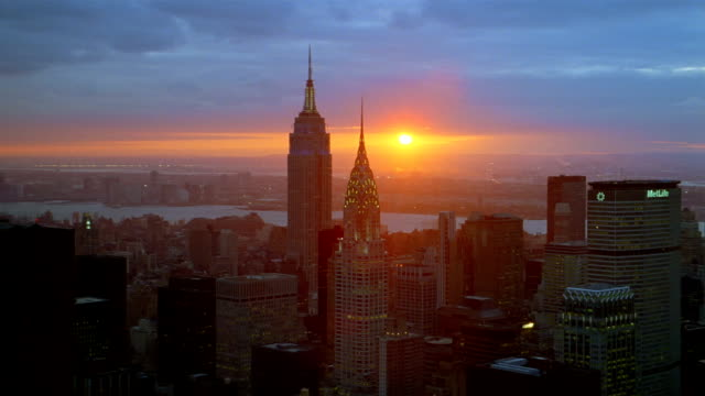 Aerial Empire State Building and Chrysler Building in Manhattan at sunset / New York City