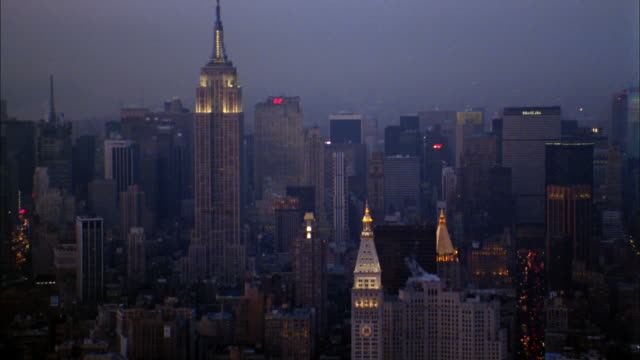Aerial Empire State Building and Manhattan skyline at night