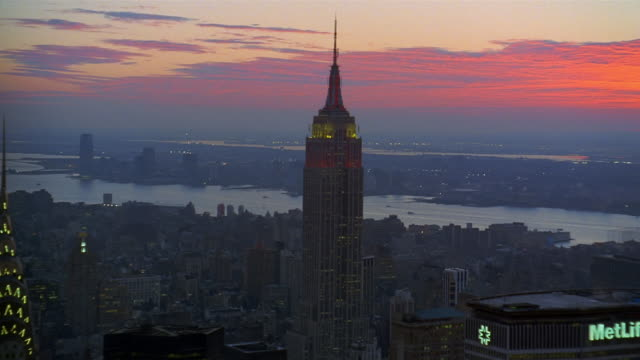 stockvideo's en b-roll-footage met aerial empire state building with hudson river in background / chrysler building in foreground / sunset / nyc - chrysler
