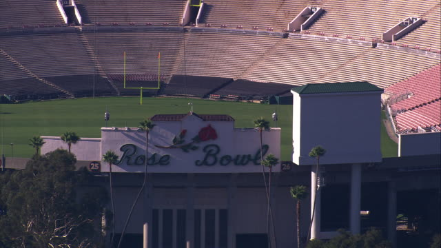 aerial la ecu of entrance to rose bowl stadium / pasadena, california, united states.   - entrance sign stock videos & royalty-free footage