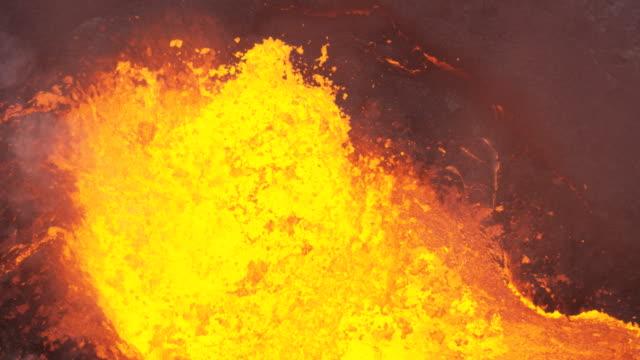 aerial erupting volcano emitting poison gases into atmosphere - 火山点の映像素材/bロール